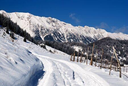 Winter rural landscape in Romania, Sirnea village, Carpathians Stock Photo - 9792556