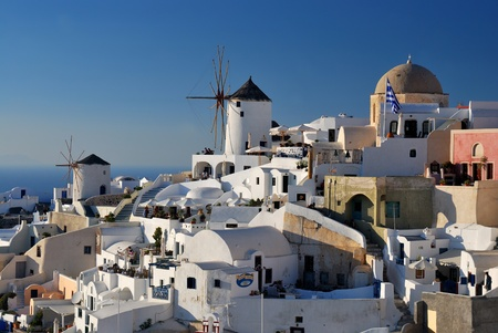 Oia is a community on the islands of Thira (Santorini) and Therasia, in the Cyclades, Greece. Stock Photo - 9364784