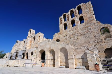 The Odeon of Herodes Atticus is a stone theatre structure located on the south slope of the Acropolis of Athens. photo