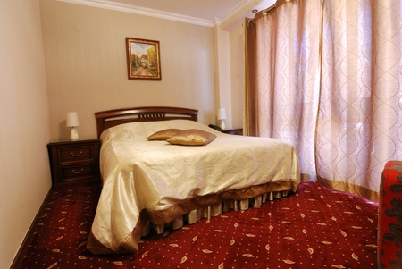 Luxury bedroom in tourist guesthouse Stock Photo - 10830690