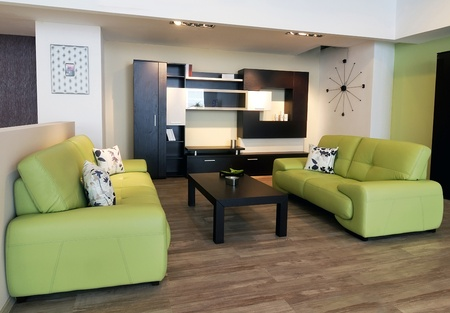 An image of a modern living room, with brown table and green sofa. 写真素材