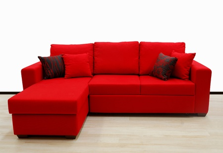 family on couch: L shape fabric four sitter sofa, red color Stock Photo