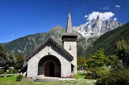 Les Praz de Chamonix medieval church and Aiguille Dru mountain in Alps