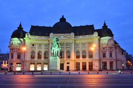 The Central University Library is located in central Bucharest with statue of Carol I, first king of Romania in front Editorial