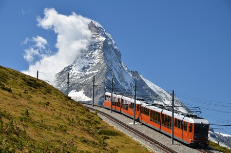 The Gornergratbahn is a 9 km long gauge mountain rack railway, with Abt rack system. It leads from Zermatt (1604 m), up to the Gornergrat (3089 m). Reklamní fotografie - 11644505