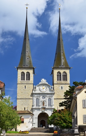 high priest: Hofkirche cathedral in Luzern is known as the Church of St. Leodegar. Switzerland Stock Photo