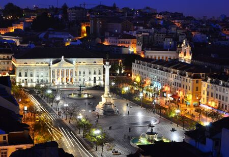 View of Rossio Square at night and Maria II Theatre, seen from Santa Just elevador.