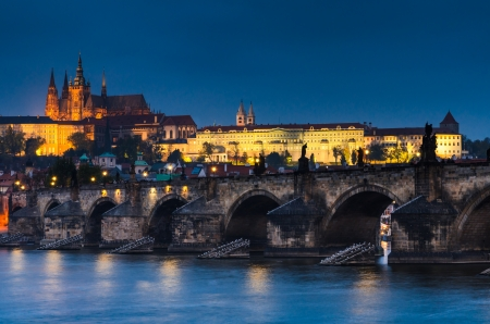 The Prague Castle (built in gothic style) and Charles Bridge are the symbols of Czech capital, built in medieval times. Twilight view of Prague Stock Photo - 16298968