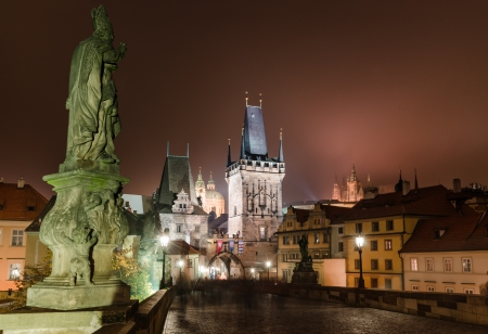 Charles Bridge with Mala Strana and Judith towers, Prague symbols joining historic quarters of Stare Mesto and Mala Strana. Czech Republic. photo