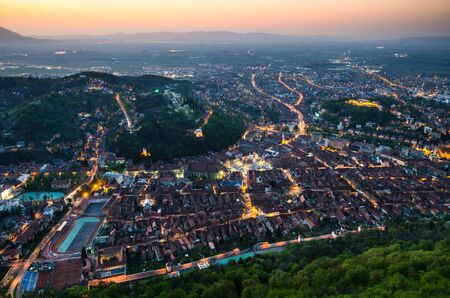 Brasov city at dusk, Romania main touristic town  photo