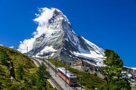 The Gornergratbahn is a 9 km long gauge mountain rack railway, with Abt rack system  It leads from Zermatt  1604 m , up to the Gornergrat  3089 m 免版税图像 - 18687668