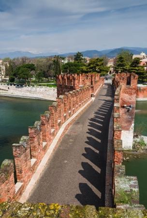 Medieval bridge of Ponte Scaligero in Verona, Italy, built in 14th century near Castelvecchio photo