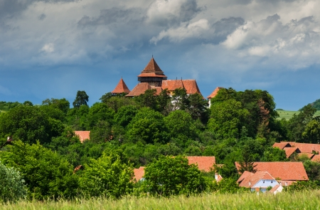 fortified: Viscri village is a saxon rural commune with fortified church in Transylvania  13th century , landmark of Romania