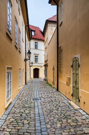 Narrow medieval pedestrian street in Prague, Cezch Republic photo