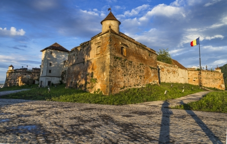 strategically: Sunset view of Brasov Fortress, part of the city outer fortification system  Stone Citadel was built in 1553 for protective purposes of Transylvania kingdom