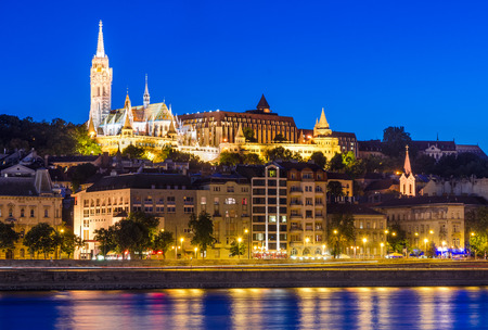nightview: Night view with Danube River, Matthias Church and Fishermen Bastion in Budapest, capitala of Hungary. Stock Photo