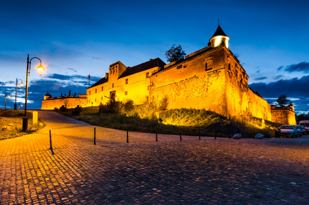 strategically: Twilight with Brasov Hill Fortress, part of the city outer fortification system. Stone Citadel was built in 1553 for protective purposes of Transylvania kingdom. Romania