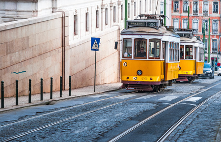 electrico: LISBON, PORTUGAL - MARCH 10: Image with Yellow Tram taken on March 10, 2010, in Lisbon, Portugal. Electrico 28 is the vintage yellow tram that plies various routes in Lisbon, crossing many touristic attractions.