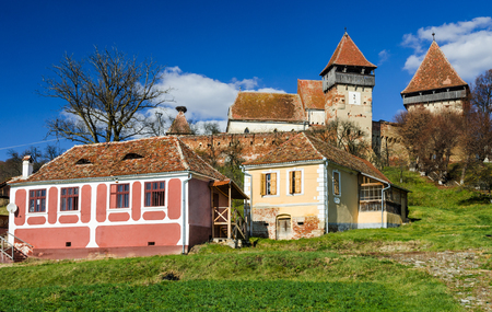 alma: Transylvania rural scenery with fortified churches. Alma Vii rural church was built in 16th century by saxons in gothic architecture style.