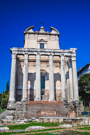 Rome, Italy. Roman Forum sight with Baroque facade of church of San Lorenzo in Miranda, on ruins of Roman temple Antoninus and Faustina. photo