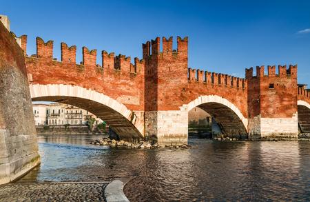 verona: Verona, Italy. Adige River and medieval stone bridge of Ponte Scaligero built in 14th century near Castelvecchio. Stock Photo