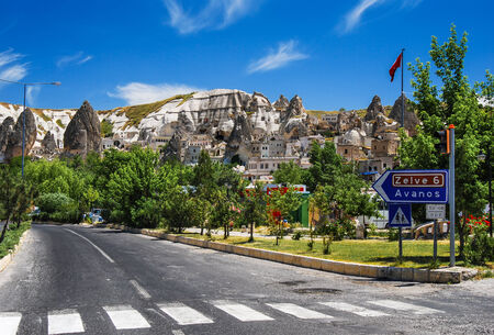 caved: Goreme small town, Cappadocia, known for fairy chimney rock formations rock caved houses. Stock Photo