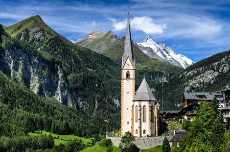 Rural landscape of Heiligenblut, North Tyrol, highest mountain from Austria in background, Grossglockner (3797 m. elevation)