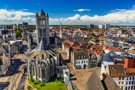 Skyline of Gent, Ghent in West Flanders, Belgium, seen from Belfort tower with St. Nicholas Church. Stock Photo