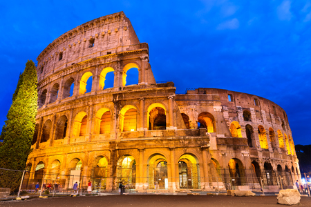 roman empire: Colosseum, Rome, Italy. Twilight view of Coliseum known as Flavian Amphitheatre an elliptical amphitheatre largest in Roman Empire built in 80AD