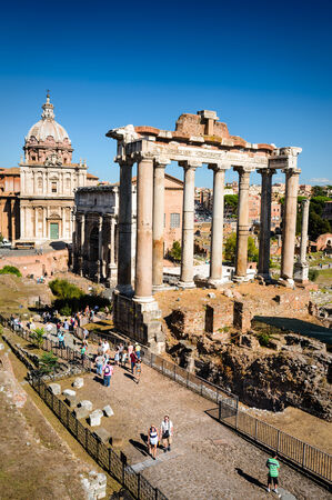 ancient rome: ROME, ITALY - 26 SEPTEMBER AUGUST 2014. Tourists visiting Roman Forum, Ancient Rome civic center of empire capital, landmark of modern Italy and world heritage.