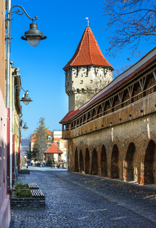 fortified wall: Sibiu, Romania. Medieval tower of stone-walled fortification of ancient city of Transylvania, romanian landmark.