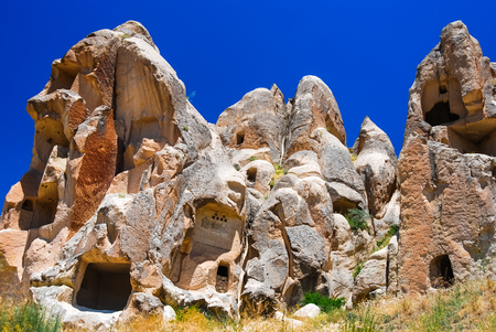 Cappadocia, Central Anatolia in Turkey. Desert landscape with ancient rock carved houses in Goreme turkish Kapadokya region in Asia Minor.