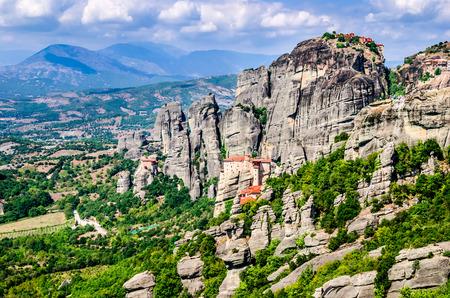 kalampaka: Meteora, Greece. Mountain scenery with Meteora rocks and Roussanou Monastery, landscape place of monasteries on the rock, orthodox religious greek landmark in Thessaly