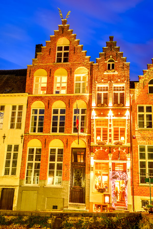 benelux: Bruges, Belgium. Night image with old medieval house facade, brickwork in Brugge, West Flanders in Benelux country.