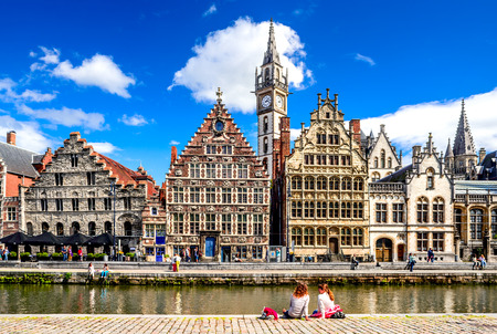 GENT, BELGIUM - 11 AUGUST 2015: Graslei historical center of Gent (Ghent) with water canal and medieval house facades, West Flanders in Belgium.