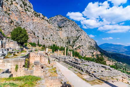to foresee: Ancient Greece. Ruins remains of the large temple of Apollo Delphi Greece greek culture landmark.