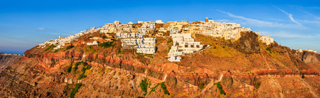 climbed: Oia Santorini. Sunset landscape with idyllic town of Oia climbed on volcanic mountain Greek Islands in Aeagean Sea