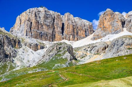 fassa: Piz Pordoi Val di Fassa Sella Dolomites in Italy. Sass Pordoi south face 2952 m in Gruppo del Sella Dolomites mountains in Alps Stock Photo