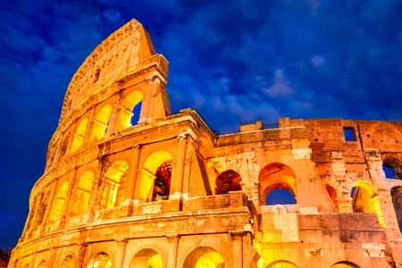 ancient civilization: Colosseum Rome Italy. Twilight view of Colosseo in Rome elliptical largest amphitheatre of Roman Empire ancient civilization.