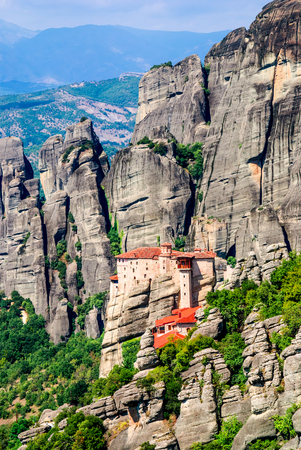 thessaly: Meteora Greece. Mountain scenery with Meteora rocks and Roussanou Monastery landscape place of monasteries on the rock orthodox religious greek landmark in Thessaly