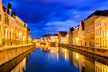 patronage: Bruges Belgium. Night shot of historic medieval buildings along water canal in Brugge Belgium