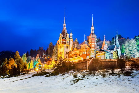 castle if: Peles Castle, Romania. Twilight image if the most famous royal castle of Romania in Sinaia landmark of Carpathian Mountains and Europe.