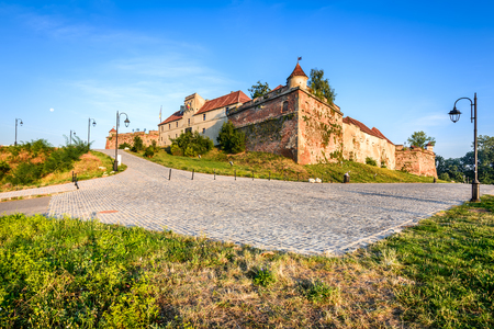 strategically: Brasov, Romania. HDR sunrise view of Brasov Fortress ( The Citadel or Fortress Hill ), part of the city outer fortification system built in 1553 for protective purposes of Transylvania.