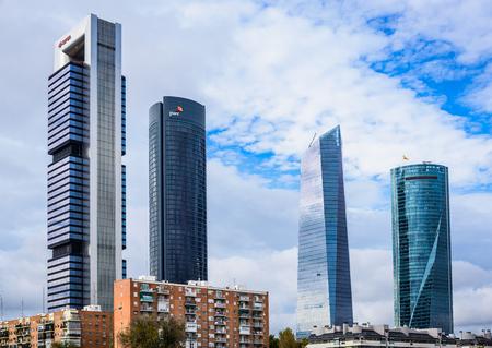 castellana: MADRID, SPAIN - 5 NOVEMBER 2015: Cuatro Torres Business Area (CTBA), business district located in the Paseo de la Castellana, Madrid Arena in Spain Editorial