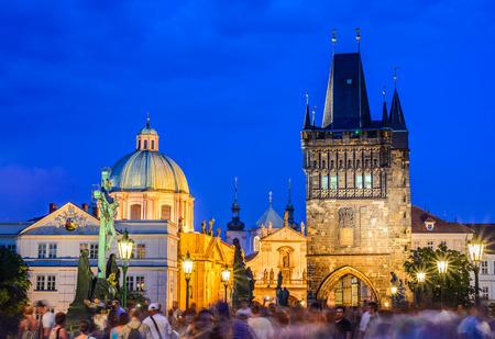 stare mesto: Prague, Czech Republic. Charles Bridge and Stare Mesto Old Town Tower. Twilight image of Bohemia capital. Stock Photo