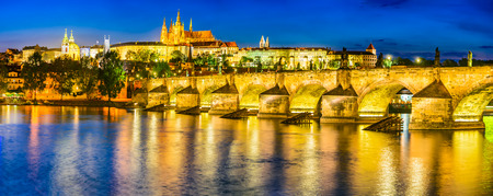 st charles: Prague, Czech Republic. Charles Bridge and Hradcany (Prague Castle) with St. Vitus Cathedral and St. George church evening dusk, Bohemia landmark in Praha.