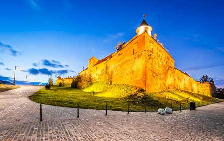 strategically: Brasov, Romania. HDR sunset twilight view of Brasov Fortress ( The Citadel or Fortress Hill ), part of the city outer fortification system built in 1553 for protective purposes of Transylvania.