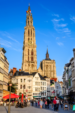 benelux: ANTWERP, BELGIUM - 10 AUGUST 2014: Tourists visiting Grote Markt and Cathedral of Our lady in Antwerp, Belgium. The church is the largest gothic in Benelux, built in 1352 in Flanders.
