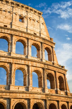 roman empire: Rome, Italy. Sunset with Coliseum, Coloseo. Colosseum ruins of ancient amphitheatre largest in Roman Empire. Stock Photo