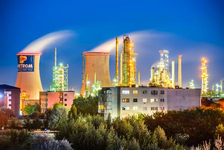 echnology: BRAZI, ROMANIA - 24 JULY 2015: Twilight image of Brazi Rafinery, OMV Petrom petrochemical oil industrial in Romania. Editorial